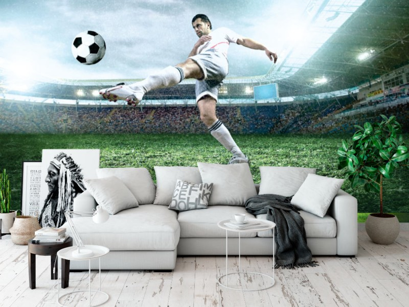 Fototapet fotbollsspelare med bollen i handling (26658985)