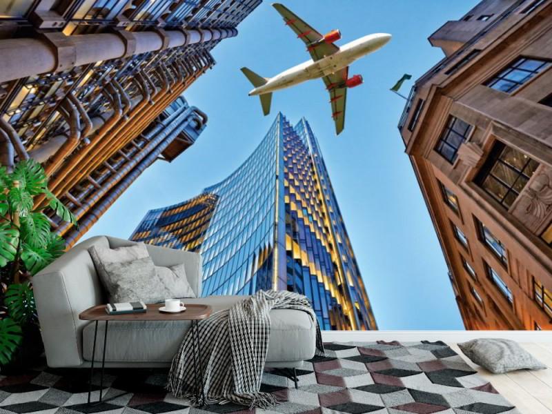Fototapet jetplan flygande över skyskrapor